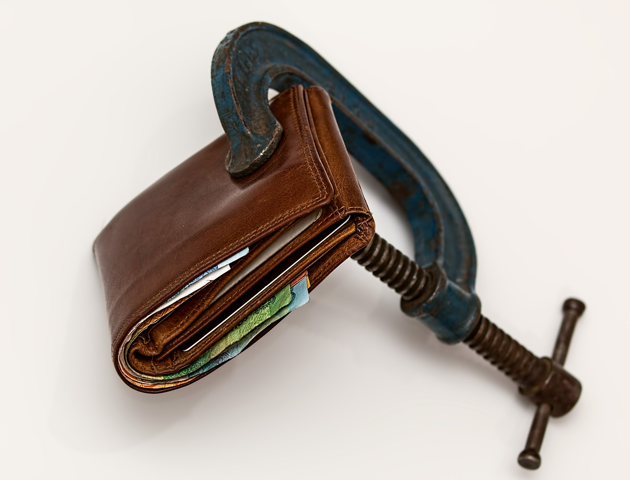 vise squeezing a wallet